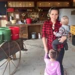montessori family in front of apple station at apple orchard