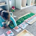child doing montessori math shelf work