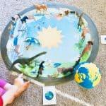 child playing with montessori seasons mat and animals