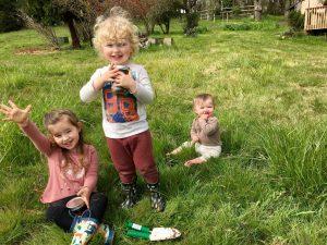 Child holding Soil Sediment jars for Garden in homeschool outdoor practical life