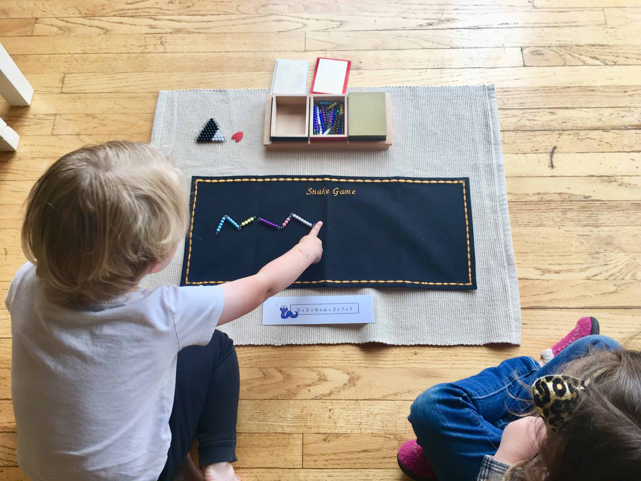 Montessori Math Addition Snake Game with Printable Activity- Building the Snake