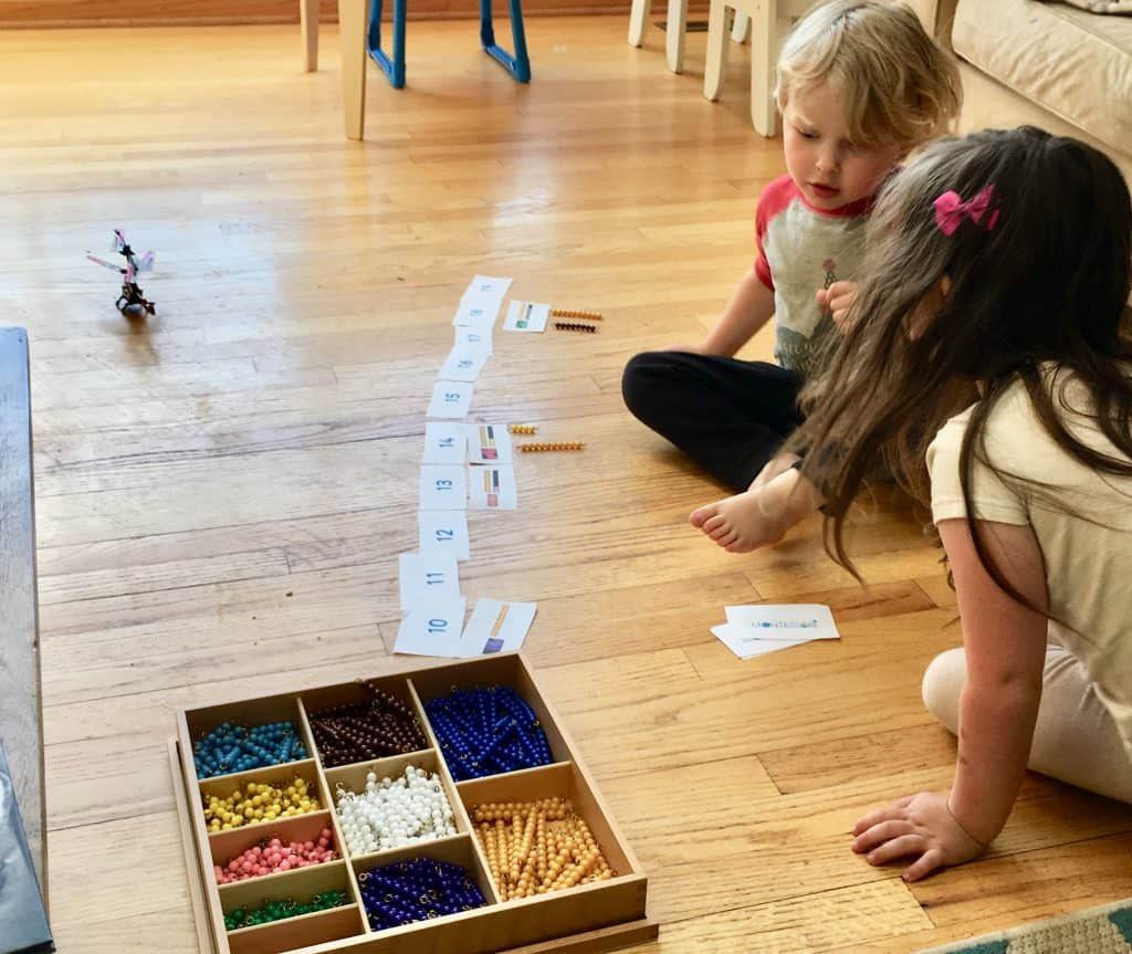 Montessori Math Kids matching quantity to numbers with truck matching game