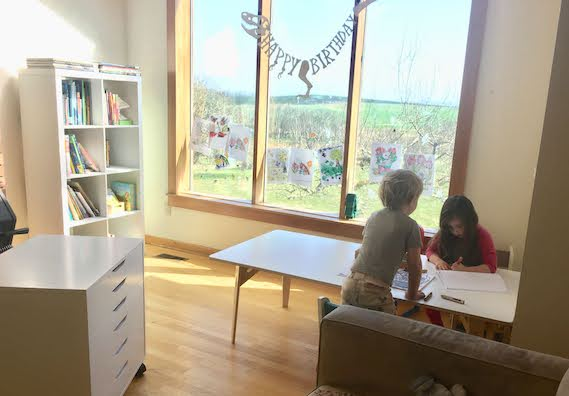 kids coloring and drawing in homeschool art space