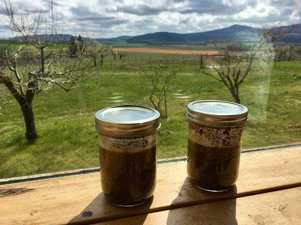 outdoor gardening soil sediment jars on a window ledge for outdoor practical life work