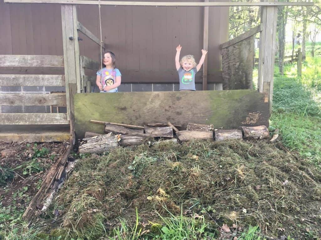 kids playing near compost