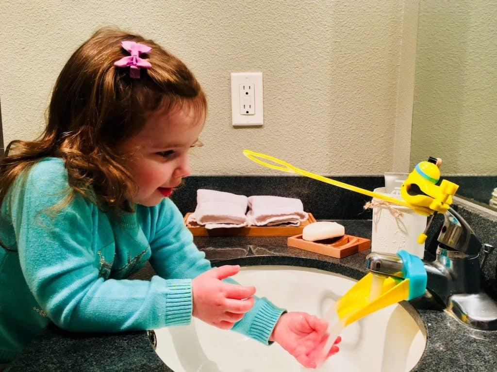 Montessori Child Washing Hands Using Sink Adapter
