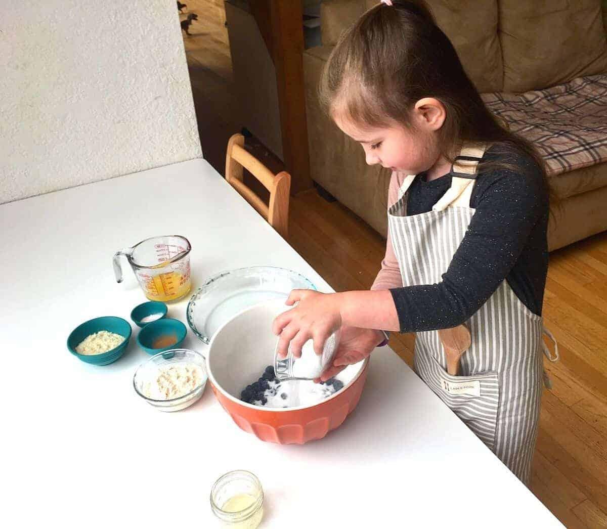 Montessori Practical Life in the Kitchen:  Baking Blueberry Cake