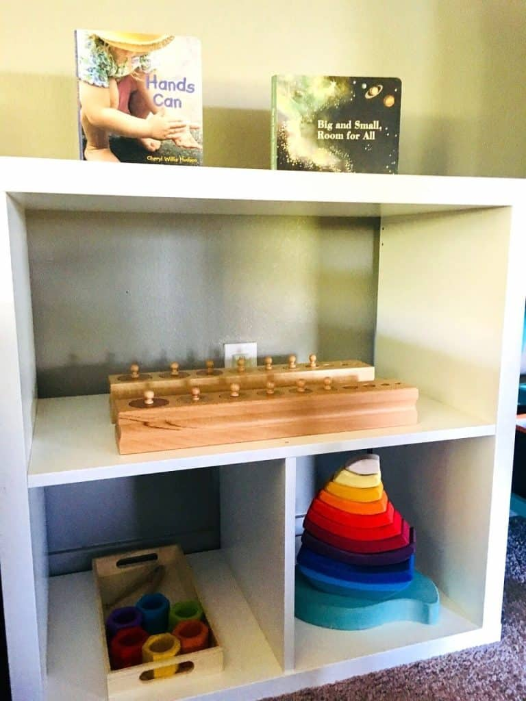Open Shelves with Montessori materials, books, and toddler toys
