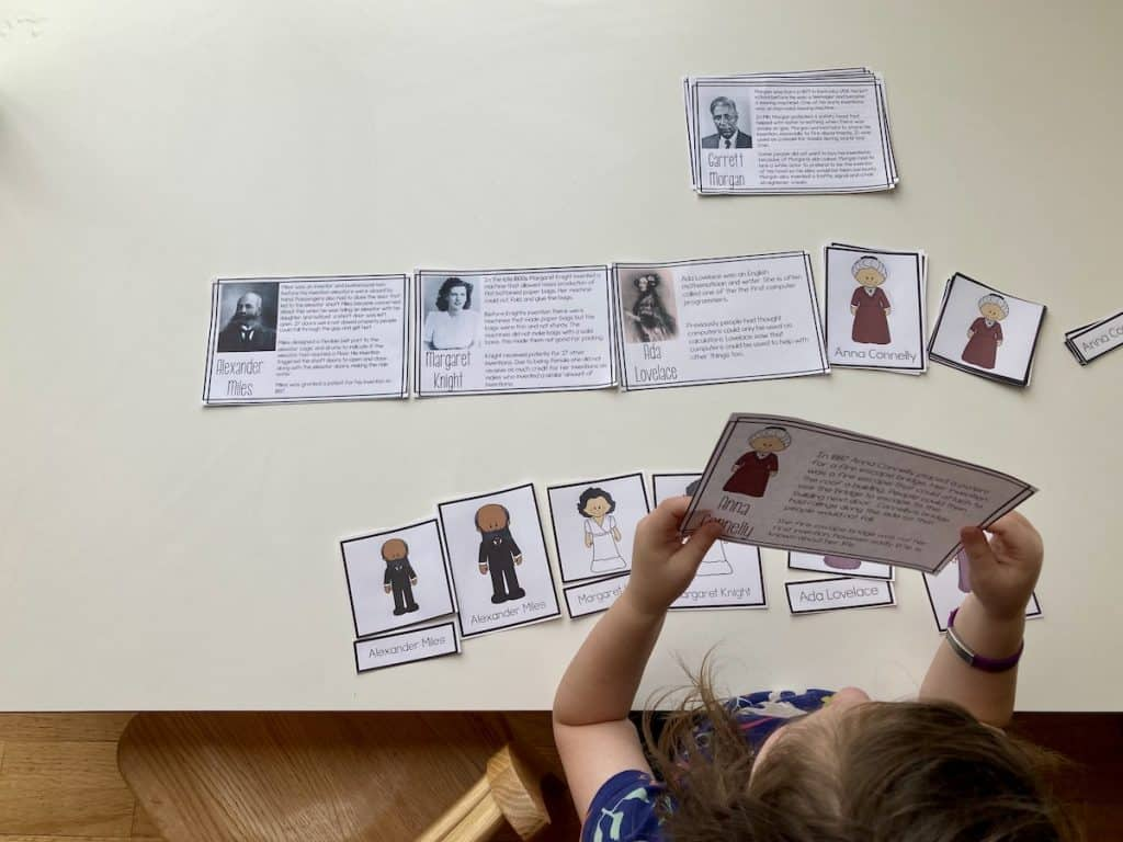 child reading papers with image and text at a table
